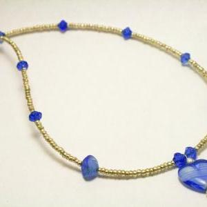 Silver and Blue Glass Heart Necklac..